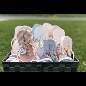 36 pairs of assorted wedding flip flops